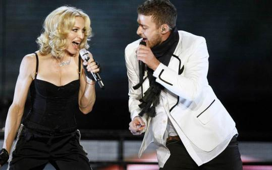 Madonna is joined by Justin Timberlake during a 35-minute free show Wednesday in New York.