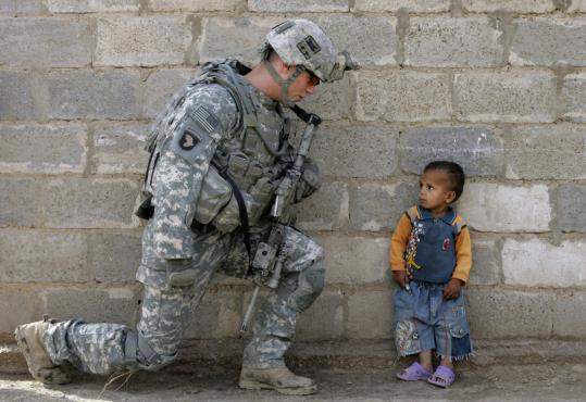 A US soldier encountered an Iraqi boy yesterday during a search mission in the Al Rudwaniyah section of Baghdad, where foreign militants were believed to be operating.