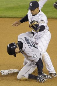Ichiro Suzuki successfully steals second base, beating second baseman Alberto Gonzalez's tag.