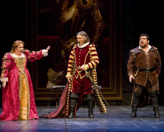 Barbara Quintiliani as Elvira, Young-Bok Kim as Silva, and Eduardo Villa as Ernani in Opera Boston's staging of 'Ernani.'