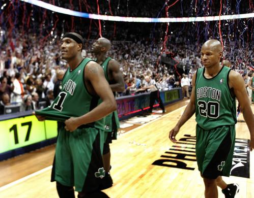James Posey (41), Kevin Garnett (5), and Ray Allen (20) walked off the court as confetti rained down celebrating the Atlanta's win in Game 6.
