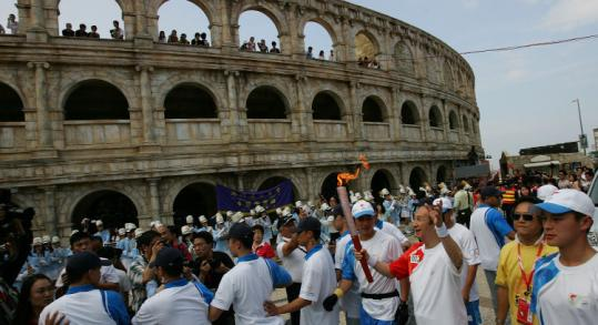 Throngs of Chinese greeted the Olympic torch yesterday in Macao. The journey through the city went smoothly.