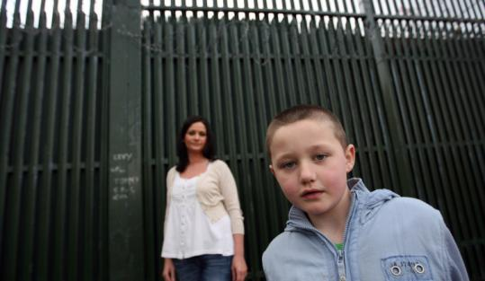 Alison Quinn and son Cein, 7, who are Catholic, live in a development that backs onto a peace wall.