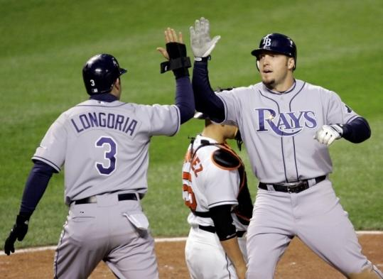 Former Red Sox utilityman Eric Hinske (right) has found a home with the Rays, and has helped them get off to a fine start.