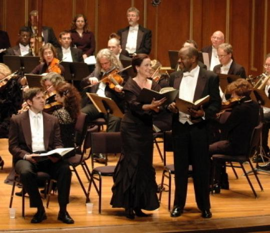 Sari Gruber (center) sings the part of Eve and Kevin Deas (right) sings Adam.