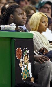 Laurence Maroney watches the Celtics blow out the Hawks yesterday.