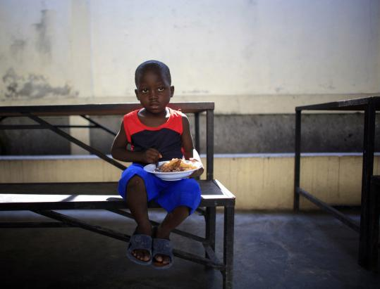 A young boy was able to find a meal at St. Clare's Church rectory in Port-au-Prince, Haiti, this week.