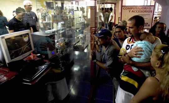 Computers went on sale Friday in Cuba, with several dozen people lining up outside a major store to gawk at the machines, the latest change under President Raul Castro.