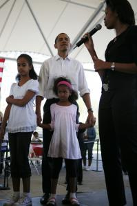 Presidential candidate Barack Obama and his two daughters Malia, 9, (left), and Sasha, 6, listened to his wife Michelle introduce him yesterday at a family picnic in Fort Wayne, Ind.