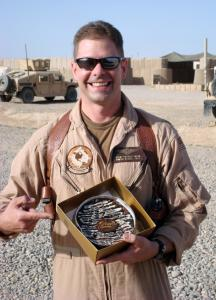 Kevin Muir of the 101st Airborne Division in Iraq with a Bake Me a Wish! cake.