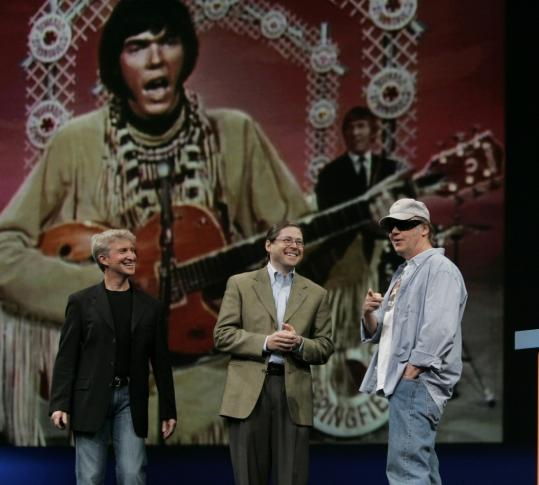 Neil Young (right) at Sun Microsystems' JavaOne Conference in San Francisco. With him are Sun CEO Jonathan Schwartz (center) and Sun vice president Rich Green.