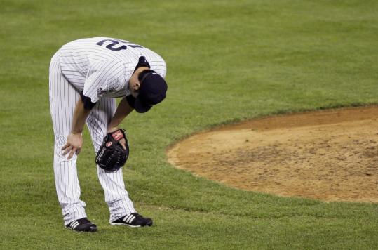 Yankees reliever Joba Chamberlain can't believe he just gave up a three-run homer to David Dellucci in the eighth inning, giving the Indians a 5-3 lead.
