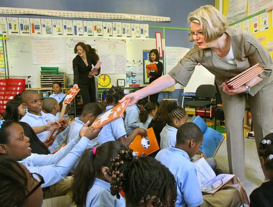 US Secretary of Education Margaret Spellings (right) visited Edward W. Brooke Charter School in Roslindale yesterday, where she looked in on second-grade classes and handed out copies of the book 'Horton Hears a Who' by Dr. Seuss.