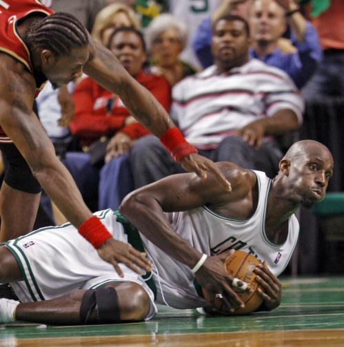 Boston's Kevin Garnett hits the floor as he beats Cleveland's Ben Wallace to a loose ball.