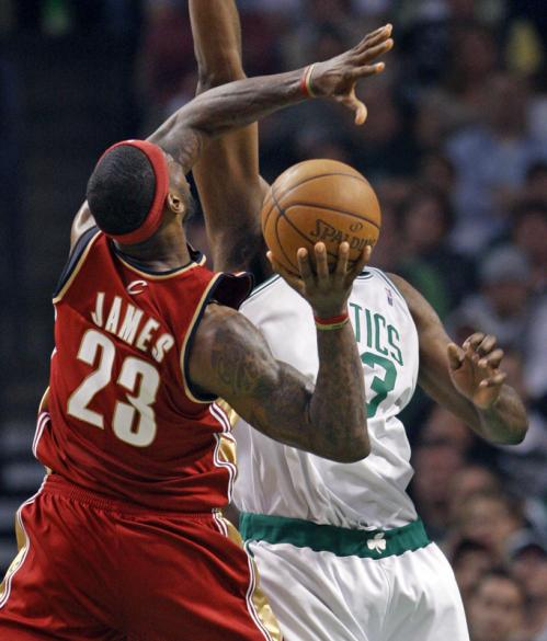 Boston's Kendrick Perkins defends Cleveland's LeBron James.