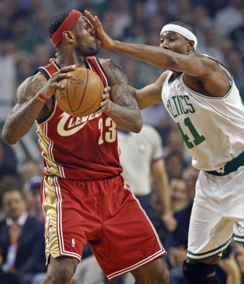 Boston's James Posey (41) plays some in-your-face defense against Cleveland's LeBron James.