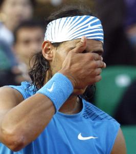 Rafael Nadal was bothered by a blister on his right foot and lost on clay for only the second time in his last 105 matches.