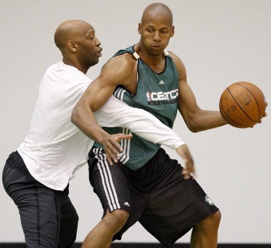 Ray Allen (right), who was held scoreless (for only the second time in his NBA career) in Game 1 Tuesday night against Cleveland, was guarded closely by Sam Cassell in practice yesterday.