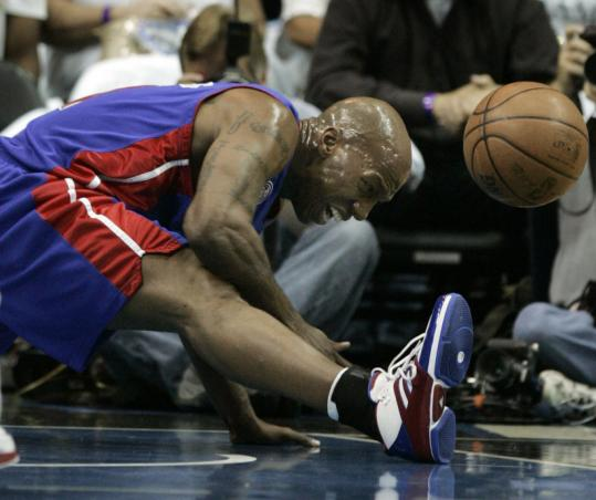 The strain gets to Chauncey Billups after the Pistons' All-Star point guard injured his right hamstring during the first quarter of Detroit's Game 3 loss to Orlando.