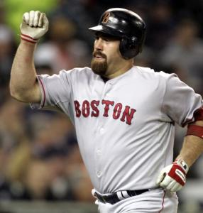 Kevin Youkilis crosses the plate in the sixth after hitting his second homer of the night, which brought the Sox within 8-5.