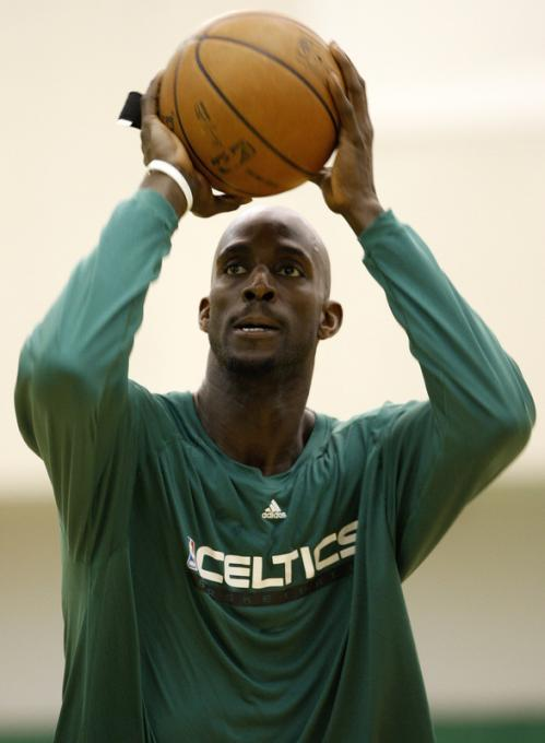 Boston Celtics forward Kevin Garnett works on his shooting after Wednesday's practice.