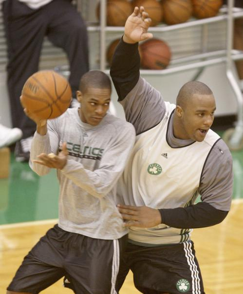 Rajon Rondo, left, is covered by teammate Glen Davis.