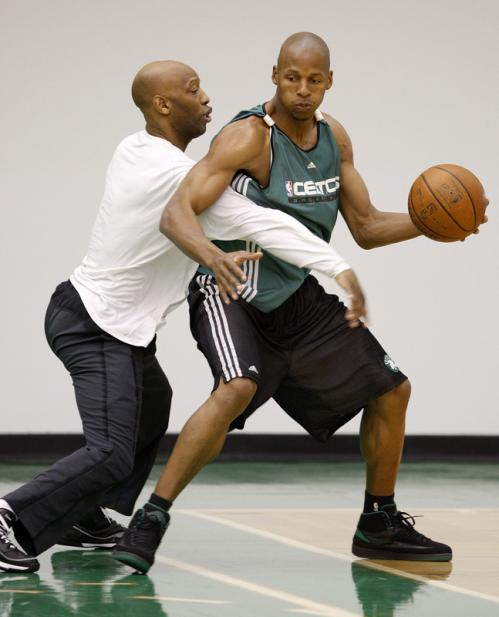 Boston Celtics guards Sam Cassell, left, and Ray Allen worked on a little 1-on-1 at the end of practice.