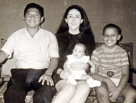Lolo Soetoro and Ann Dunham pose with daughter Maya Soetoro and son Barack Obama in an undated photo.