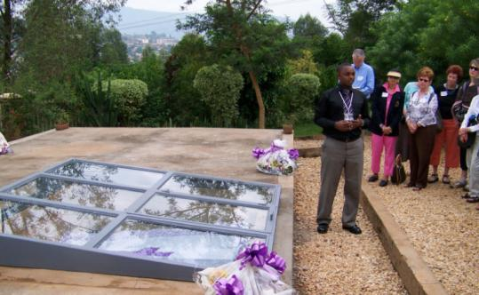 At the Kigalia memorial, a tour guide, some of whose family were genocide victims, talks at the grave for 250,000 people.