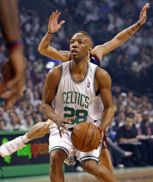 Celtics guard Sam Cassell looks like he has an extra set of arms as the Cavs' Delonte West flies by him on defense in the first half.