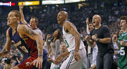 Celtics guard Ray Allen (center) brought the fans out of their seats with this first half three-point attempt. This one didn't drop, but he later finally ended his three half scoring drought. The Cavs Delonte West is at far left.