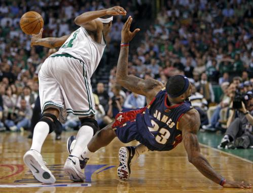 Cleveland forward LeBron James hits the floor at right as the Celtics' James Posey (left) beats him to a second half loose ball.