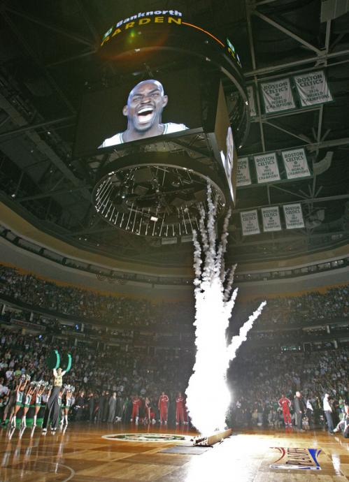 Celtics forward Kevin Garnett is seen on the scoreboard as the pyrotechnic show during the pregame show goes off, illuminating the championship banners in the rafters.