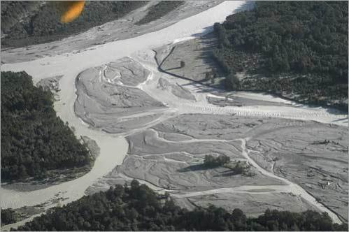 An aerial view shows the Yelcho River covered with ashes near Chaiten town, located some 760 miles south of Santiago on May 4.