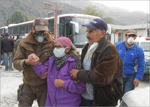 Residents wear protective masks as they evacuate the nearby village of Futaleufu, which is located some 900 miles south of Santiago.