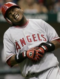The Angels' Erick Aybar winces after being hit on the hand by a pitch from James Shields in the fourth inning.