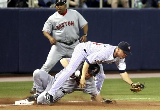 J.D. Drew got under the tag of Twins third baseman Matt Tolbert in the second inning.