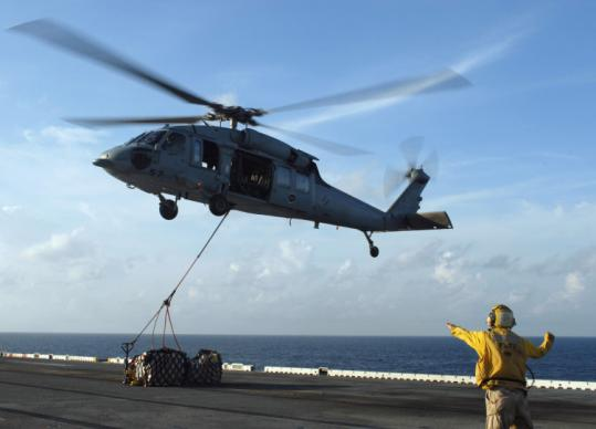 A Navy Seahawk helicopter took off from the USS Essex in the Gulf of Thailand yesterday with pallets of food, water, and emergency supplies intended for Burma.