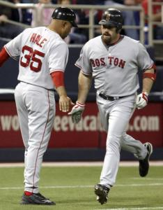 It's become habit for third base coach DeMarlo Hale (left), as Kevin Youkilis circles the bases for the sixth time this week.
