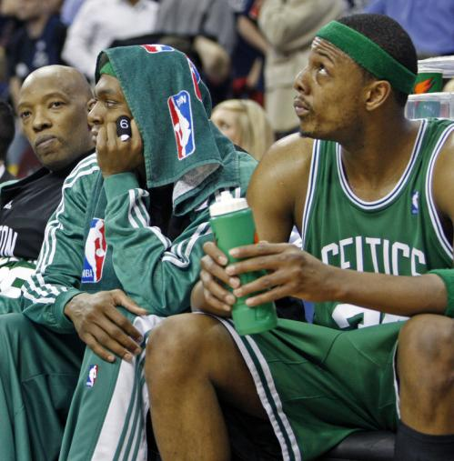 Celtics guard Sam Cassell, guard Rajon Rondo and forward Paul Pierce sat on the bench late in the game.