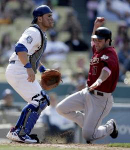 Dodgers catcher Russell Martin had plenty of company in the eighth. Lance Berkman was one of six Astros to score in the inning.