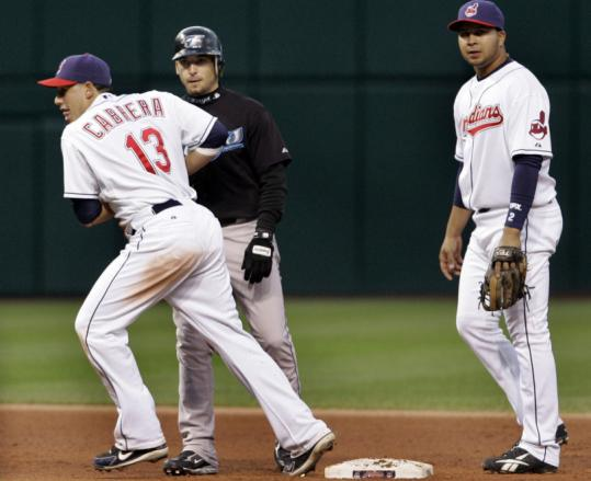 Indians second baseman Asdrubal Cabrera tags out Toronto's Marco Scutaro to complete an unassisted triple play in the fifth inning.
