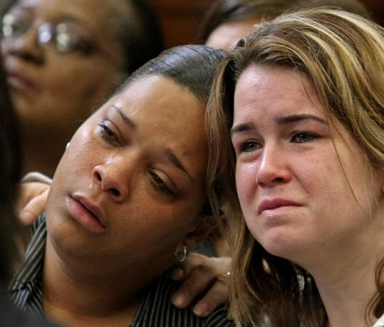 Anna Reisopoulos (right) sometimes wept yesterday in South Boston Municipal Court as she stared at Nicole Chuminski, the 25-year-old woman accused in the arson that killed two of Reisopoulos's three children.