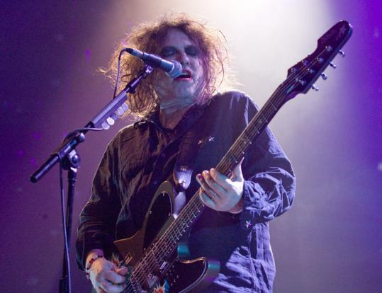 Robert Smith and The Cure chose from three decades of music to delight a packed Agganis Arena last night in a show lasting nearly three hours.