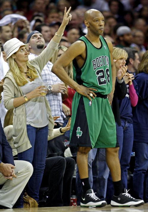 A front-row fan gives Celtics guard Sam Cassell the 'rabbit ears' as he waits to inbound the ball late in the fourth quarter.