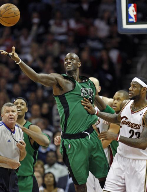 Celtics forward Kevin Garnett tries to control the ball after he and LeBron James (23) had a second-quarter jump ball.
