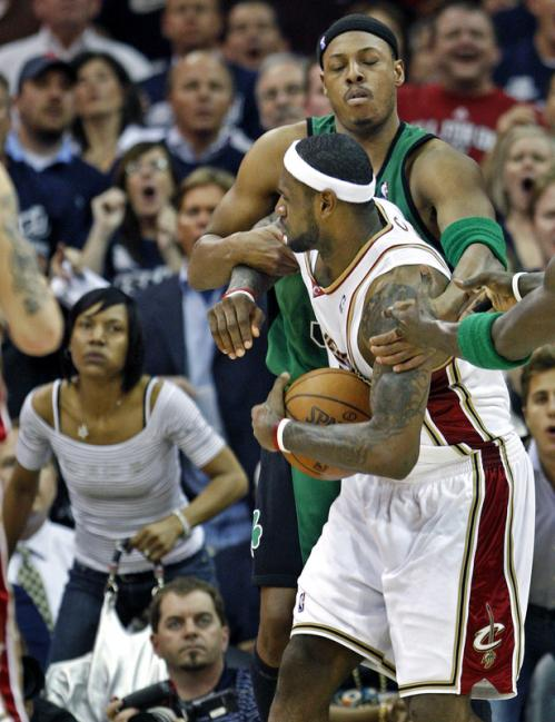 Cavaliers forward LeBron James is fouled hard by the Celtics Paul Pierce in the second quarter, which brought his mother, Gloria (background), out of her seat.