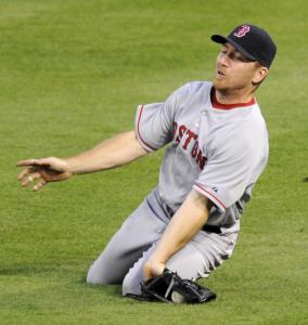 Red Sox right fielder J.D. Drew sprained his left wrist while trying for this Freddie Bynum single in the third inning and was forced to leave the game.