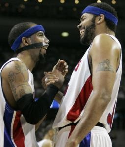 Pistons Richard Hamilton (left) and Rasheed Wallace laugh about a hoop Hamilton made in the first half.