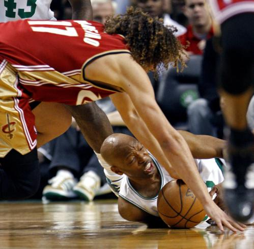 Cavaliers forward Anderson Varejao, top, and Celtics guard Sam Cassell battle for a loose ball.